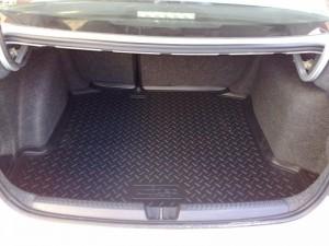 На фото - полиуретановый коврик Norplast для багажника, alta-karter.ru