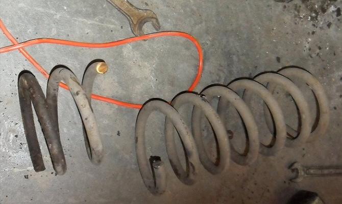 Срезание витков пружины амортизатора