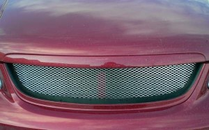 На фото - новая решетка радиатора Киа Спектра, exist-tuning.ru